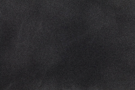 Schwarz Wildleder Stoff Nahaufnahme. Velvet Textur Hintergrund Standard-Bild