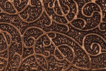 bronze background: Luxury metallic bronze background with textures and patterns.