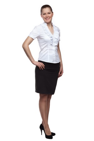 pretty brunette woman: Full face of a young woman dressed in office-style full-length isolated on white background. Stock Photo