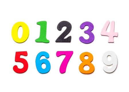 Wooden colorful numbers close-up, scattered on a white background