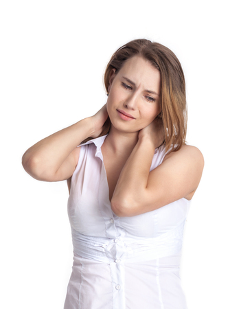 Beautiful young woman is experiencing pain in the neck. The emotions of the sick person.
