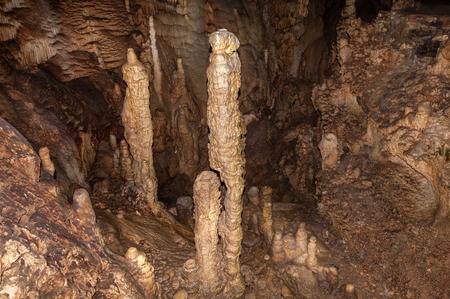 dark cave: High mineral stalagmites inside the dark cave. Stock Photo