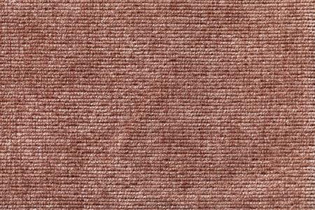 soft textile: Brown background from a soft textile material. sheathing fabric with natural texture. Cloth backdrop. Stock Photo