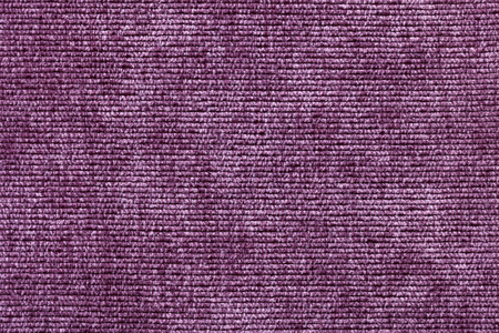 soft textile: Purple background from a soft textile material. sheathing fabric with natural texture. Cloth backdrop.