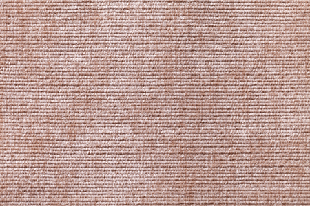 soft textile: Light brown background from a soft textile material. sheathing fabric with natural texture. Cloth backdrop. Stock Photo
