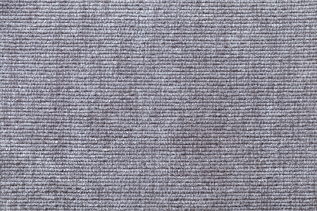 soft textile: Light gray background from a soft textile material. sheathing fabric with natural texture. Cloth backdrop.