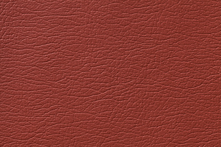 leatherette: Dark red leather texture background with pattern, closeup.