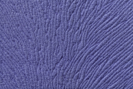 soft textile: Violet background from a soft wool textile material closeup. Fabric with natural texture. Cloth backdrop. Stock Photo