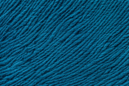 soft textile: Blue background from a soft wool textile material closeup. Fabric with natural texture. Cloth backdrop. Stock Photo