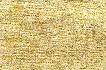 soft textile: Light yellow background from a soft textile material. sheathing fabric with natural texture. Cloth backdrop. Stock Photo