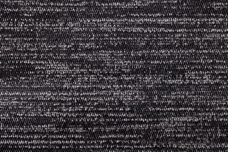 soft textile: Black and white background from a soft textile material. sheathing fabric with natural texture. Cloth backdrop.