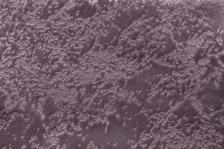 Dark brown background from a soft upholstery textile material, closeup. Fabric with natural texture. Cloth backdrop.