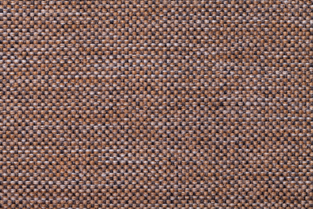 Dark brown background with checkered pattern, closeup. Structure of the fabric macro. Stock Photo
