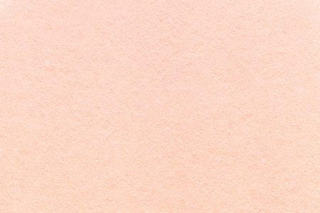 Texture of old light pink paper background, closeup. Structure of dense coral cardboard Reklamní fotografie