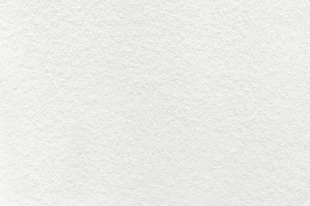 Texture of old light white paper background, closeup. Structure of dense cream cardboard. Archivio Fotografico
