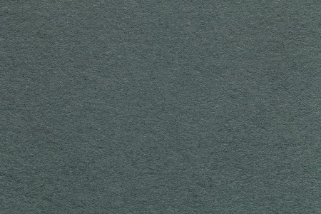 Texture of old green paper background, closeup. Structure of dense gray cardboard.