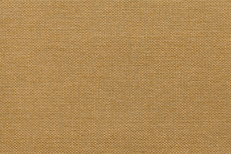 Light brown background from a textile material with wicker pattern, closeup. Structure of the bronze fabric with natural texture. Cloth backdrop. Stock Photo