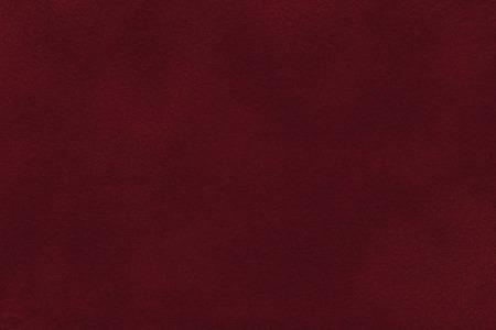 Background of dark red suede fabric closeup. Velvet matt texture of wine nubuck textile. Stok Fotoğraf - 84720208