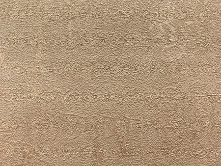 Texture of light brown plush wallpaper with a pattern. Textile bronze surface, structure close-up. Stock Photo