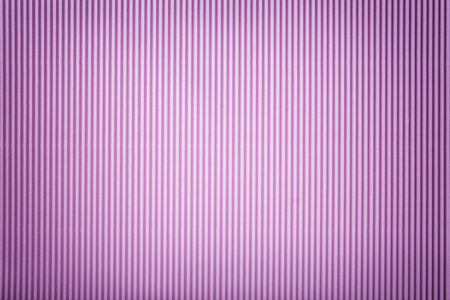 Texture of corrugated light violet paper with vignette, macro. Striped pattern of lilac cardboard background, closeup.