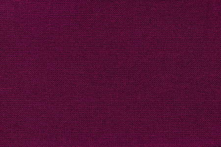 Dark wine background from a textile material with wicker pattern, closeup. Structure of the purple fabric with texture. Cloth backdrop. Reklamní fotografie