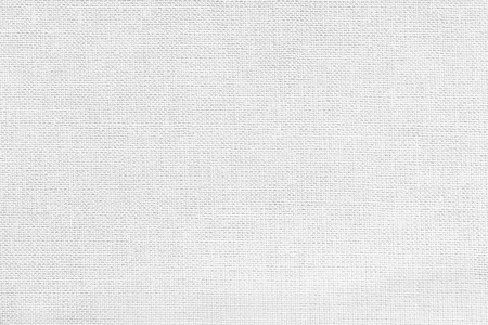 White background from a textile material with wicker pattern, closeup. Structure of the snow-white fabric with texture. Cloth backdrop.