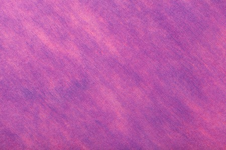 Structure of a light purple background with pink spots of felt fabric, closeup. Texture of woolen magenta matt textile. Cloth backdrop. Reklamní fotografie