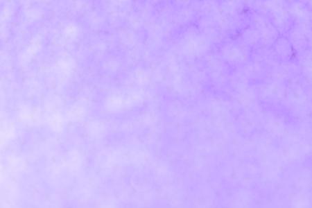 Blurred orchid background with circle sparkling lights. Shiny lilac glittery bokeh of christmas garland. Dark violet backdrop Reklamní fotografie