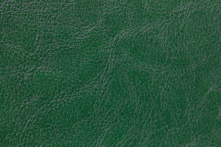 Dunkelgrüner Lederbeschaffenheitshintergrund, Nahaufnahme. Smaragdgrüner Hintergrund aus Faltenhaut, Textilstruktur.