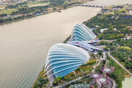 Singapore - 07 July 2018: Aerial view of the botanical garden, Gardens by the Bay in Singapore. Supertrees Marina Bay. Top view of the glass greenhouse