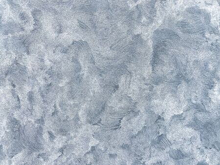 Texture decorative blue plaster imitating the old peeling wall. Silver wallpaper cracked background, closeup. Imagens