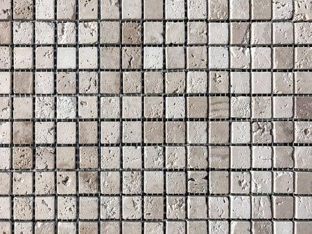 Stone tile mosaic for decoration the bathroom and pool. Ceramic beige texture background.