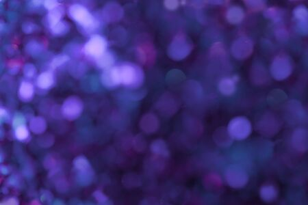 Navy blue sparkling background from small sequins, closeup. Brilliant and diamond purple backdrop. Standard-Bild