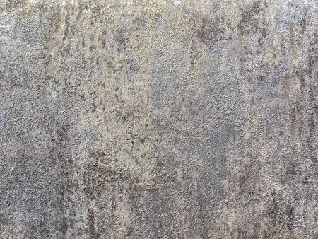 Structure of silver abstract background in the form of a rough patchy plaster of gray brown color. Texture of colorful decorative wallpaper, closeup. Imagens