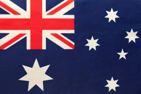 Australia national fabric flag, textile background. Symbol of international world country. State official sign. Banco de Imagens