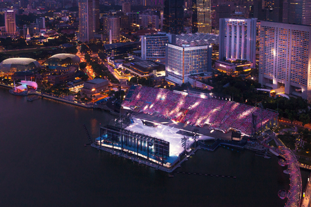 Singapore - 07 July 2018: night city from a height. Festive show to the day of the city on the floating stadium in the Marina Bay. Editorial