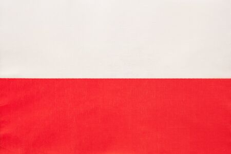 Poland national fabric flag with emblem, textile background. Symbol of international world european country. State official sign. Stockfoto