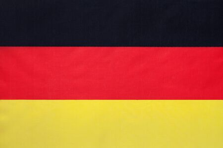 German national fabric flag with emblem, textile background. Symbol of international world european country. State official sign.