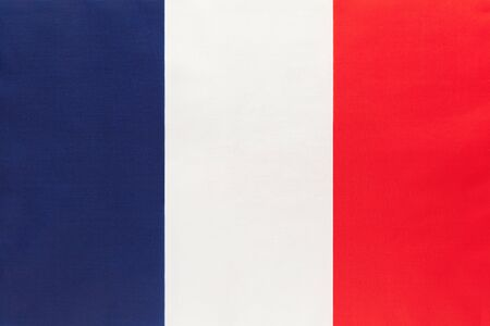France national fabric flag with emblem, textile background. Symbol of international world european country. State official french sign.