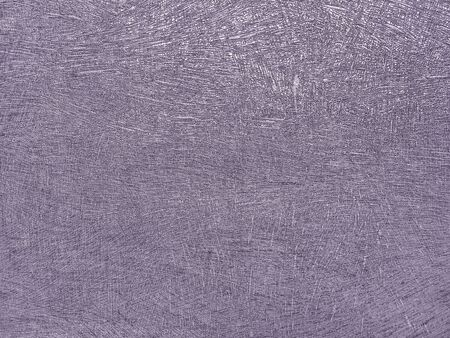 Texture of purple wallpaper with a curly pattern. Violet paper surface, structure close-up.