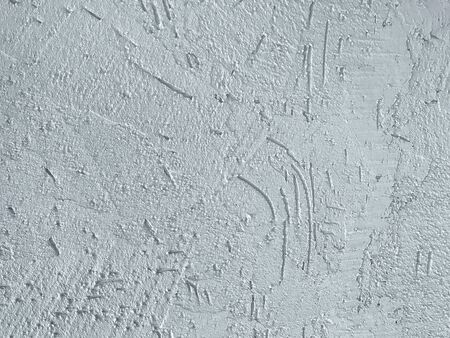 Texture decorative blue plaster imitating the old peeling wall. Obsolete sky cracked background, closeup