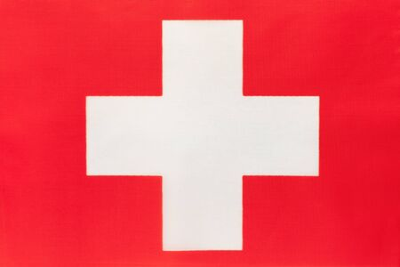 Switzerland national fabric flag with emblem, textile background. Symbol of international world european country. State official swiss sign.