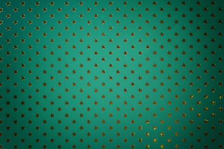 Dark green background from metal foil paper with a pattern of sparkling golden stars, closeup. Texture of turquoise metallized wrapping holiday paper surface with vignette.