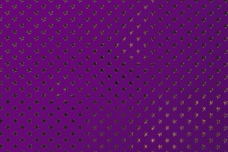 Dark purple background from metal foil paper with a pattern of sparkling golden stars, closeup. Texture of violet metallized wrapping holiday paper surface. Stok Fotoğraf