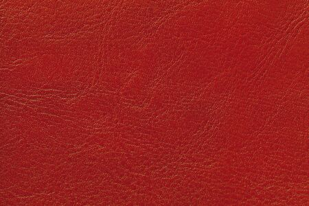 Dark red leather texture background, closeup. Brick cracked backdrop from wrinkle skin, structure of textile. Фото со стока