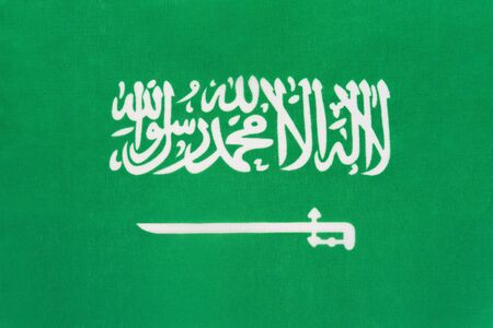 Saudi Arabia national fabric flag with emblem, textile background. Symbol of international world asian country. State official arabian sign. Stok Fotoğraf