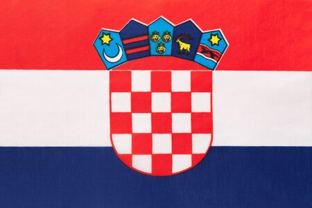 Croatia national fabric flag with emblem, textile background. Symbol of international world european country. State official croatian sign.