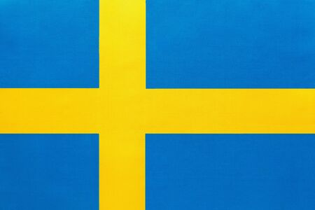 Sweden national fabric flag with emblem, textile background. Symbol of international world european country. State official swedish, scandinavian sign. Stockfoto