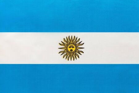 Argentina national fabric flag, textile background. Symbol of international world south America country. State official argentinian sign.