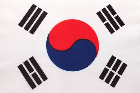 South Korea national fabric flag, textile background. Symbol of international asian world country. Korean state official sign, Stok Fotoğraf